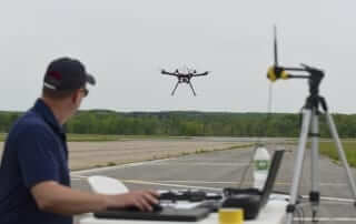 drone in air, guy monitoring flight